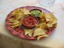Tortilla chips with salsa and guacamole dip