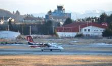 An Era Alaska flight from Anchorage taxis past the control tower at Kodiak State