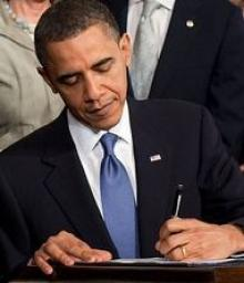 Obama signing health care legislation