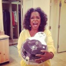 Oprah Winfrey holding ActiFry from T-Fal