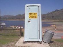 porta potty with rattlesnake warning